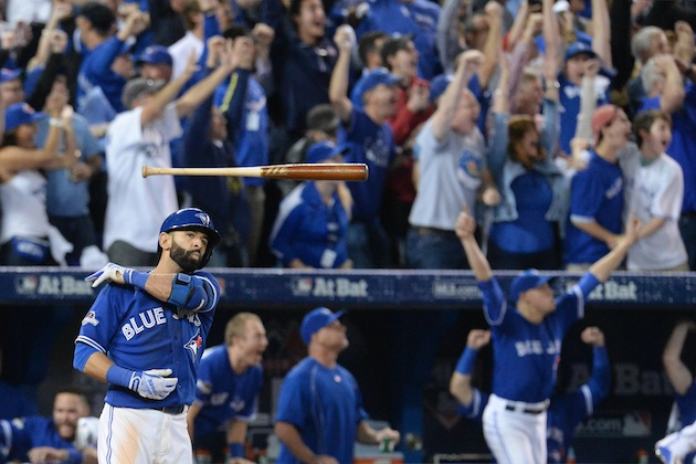 Jose Bautista of the Toronto Blue Jays flips his bat after hitting the game-winning home run in Game 5 of the ALDS against the Texas Rangers