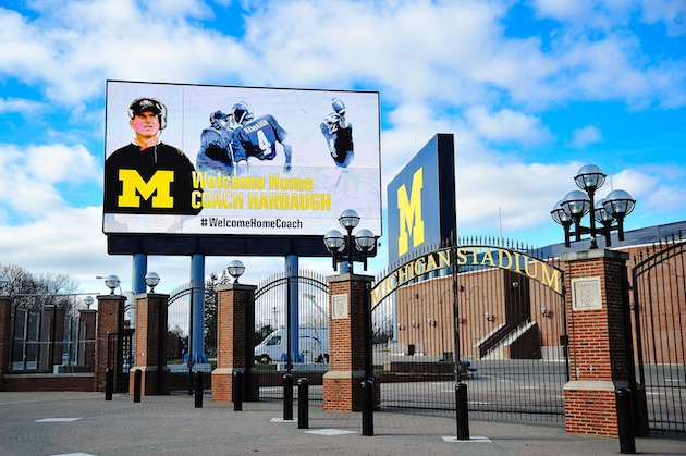 A sign outside of Michigan Stadium touting the hiring of former quarterback Jim Harbaugh as the team's new head coach.