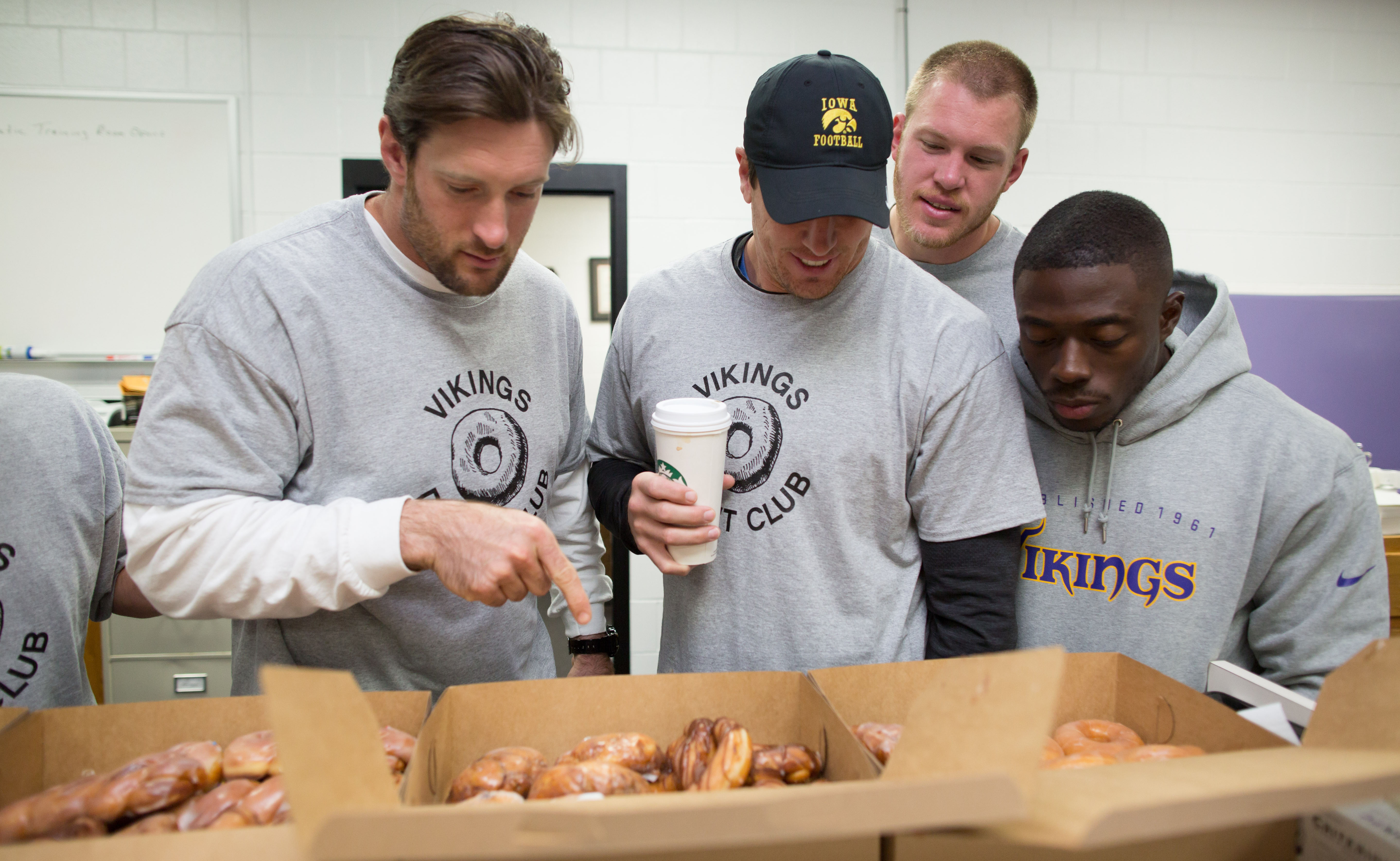 Brian Robison, Chad Greenway, Kyle Rudolph and athletic trainer Stan Delva of Vikings Donut Club.