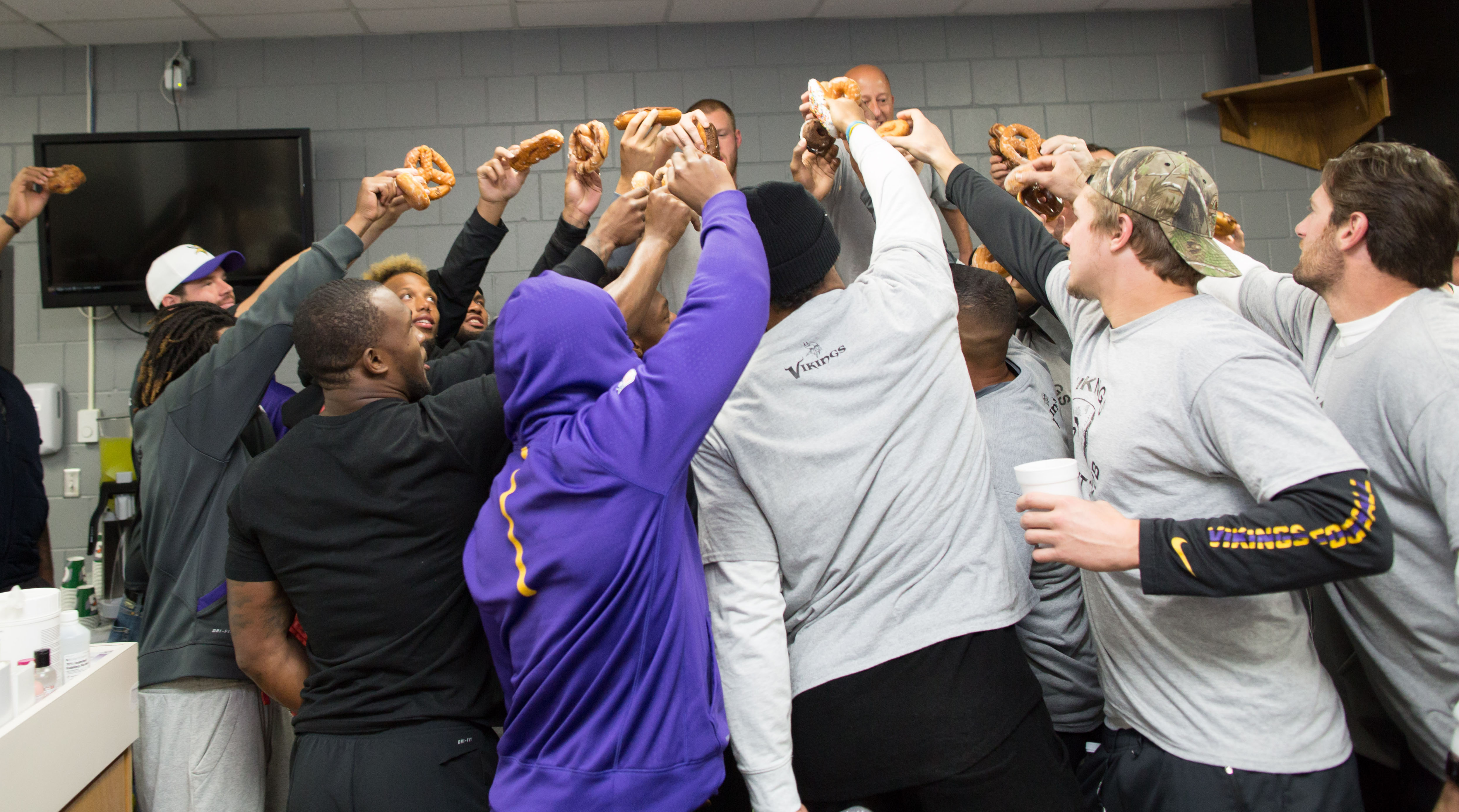Vikings Donut Club members gather for the ceremonial toasting of the donuts.