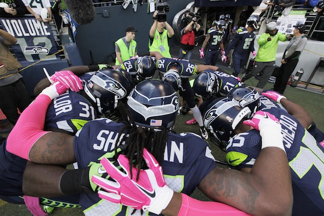 The Seattle Seahawks huddle up before a game.