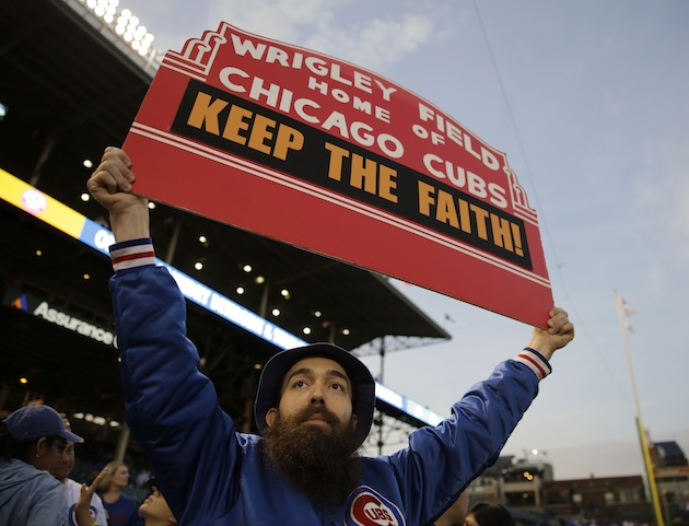 A Chicago Cubs fan holds up a sign.