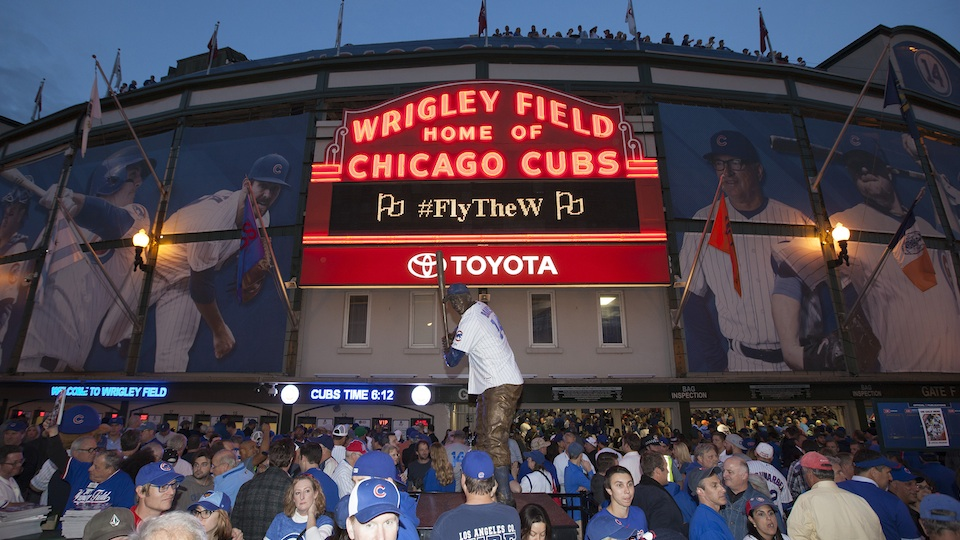 Chicago Cubs fans await outside Wrigley Field.
