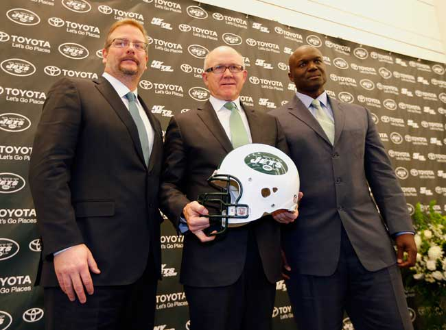 From l. to r., Jets general manager Mike Maccagnan, owner Woody Johnson and Todd Bowles at the coach's introductory press conference in January.