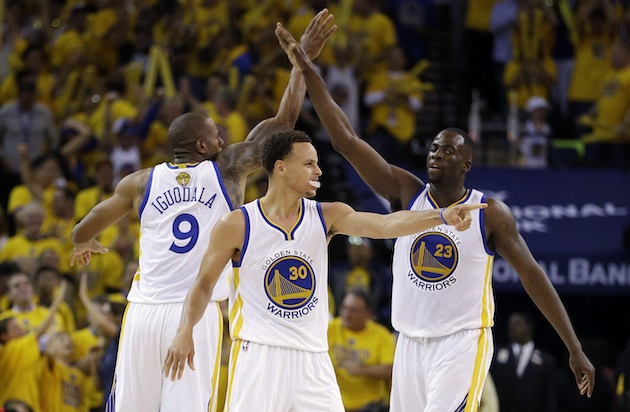 From left to right: Andre Iguodala, Stephen Curry, and Draymond Green of the Golden State Warriors.