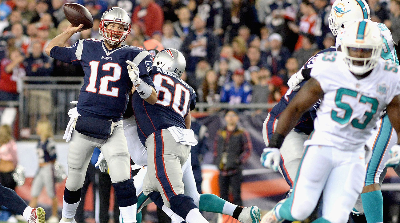 Tom Brady threw for 356 yards and four touchdowns against the Dolphins.