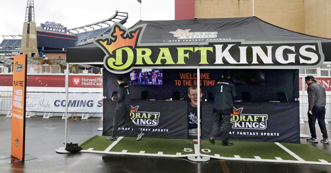 The DraftKings logo has become omnipresent at New England's Gillette Stadium. Owner Robert Kraft has a stake in the company.