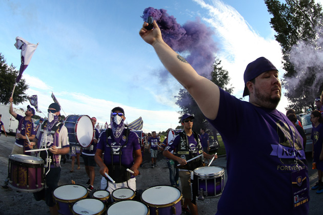 Orlando City supporters march to the match