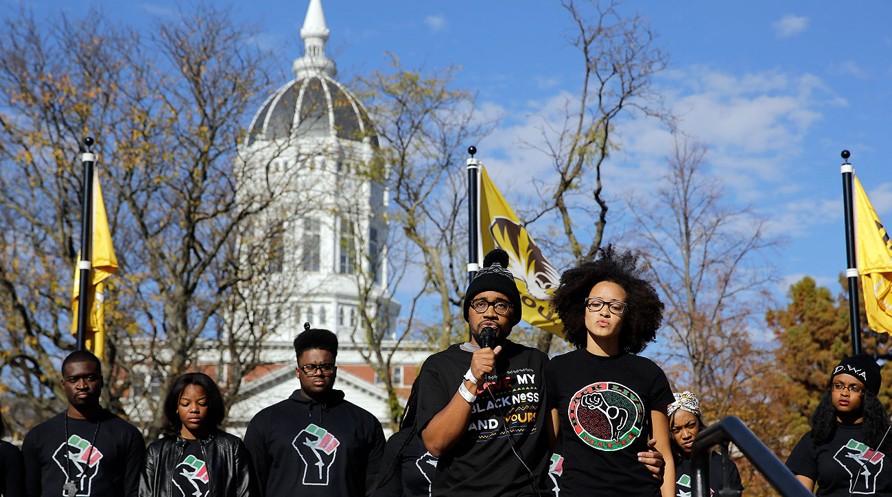 Jonathan Butler (with microphone) spoke to students Monday after ending his hunger strike.
