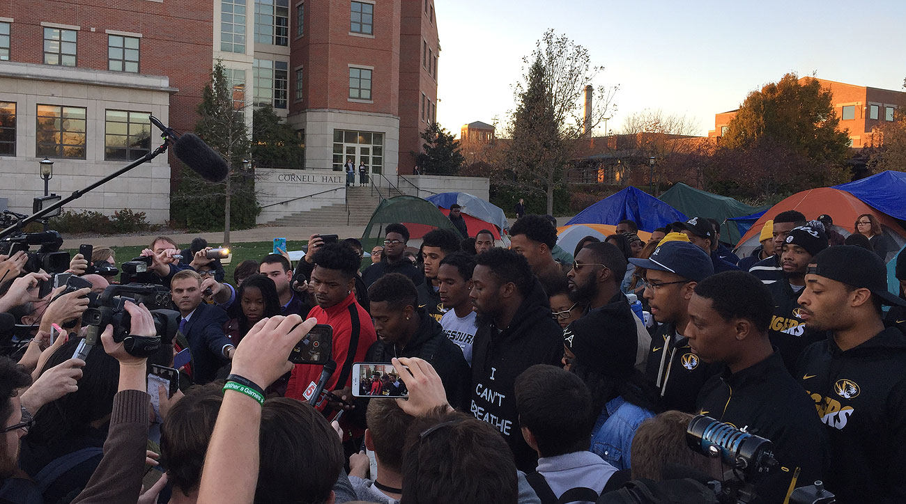 Missouri football players address the media Monday evening on Carnahan Quad.