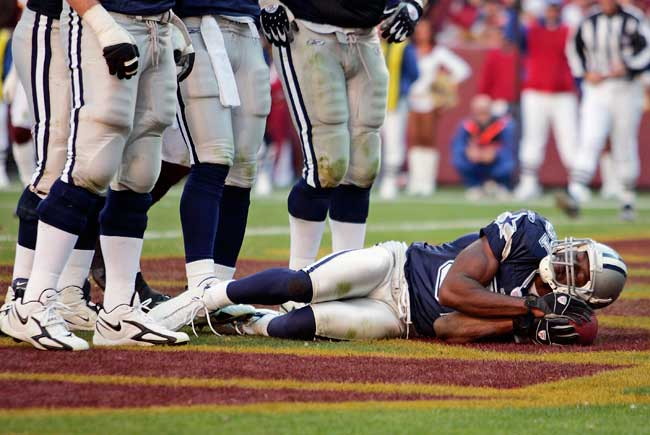 After scoring a touchdown, Terrell Owens pretends to nap with the football during a Cowboys game in November 2006.