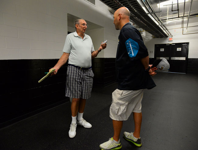 Vito Stellino, shown here interviewing Jaguars coach Gus Bradley, has covered the NFL for more than five decades years and seen it all.