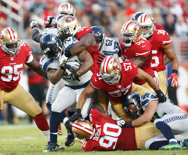 Seattle Seahawks running back Marshawn Lynch takes a handoff against the San Francisco 49ers.