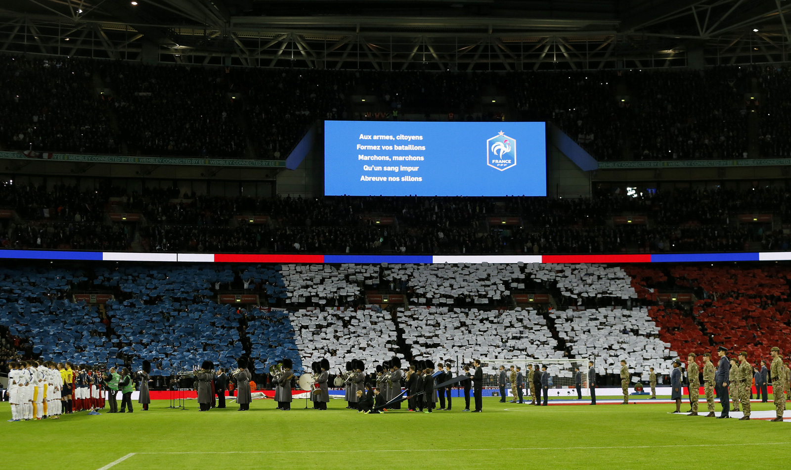 Fans make a French flag tifo at Wembley Stadium during the singing of Le Marseillaise ahead of England's friendly vs. France, which took place days after the terrorist attacks in Paris.