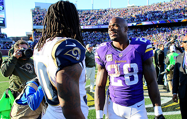 Todd Gurley and Adrian Peterson meet on the field after the Rams' overtime loss to the Vikings in Week 9.