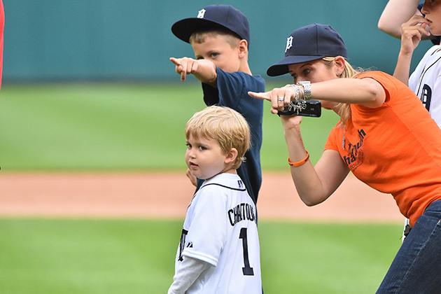 Carr throwing out the first pitch at a Tigers game this summer.