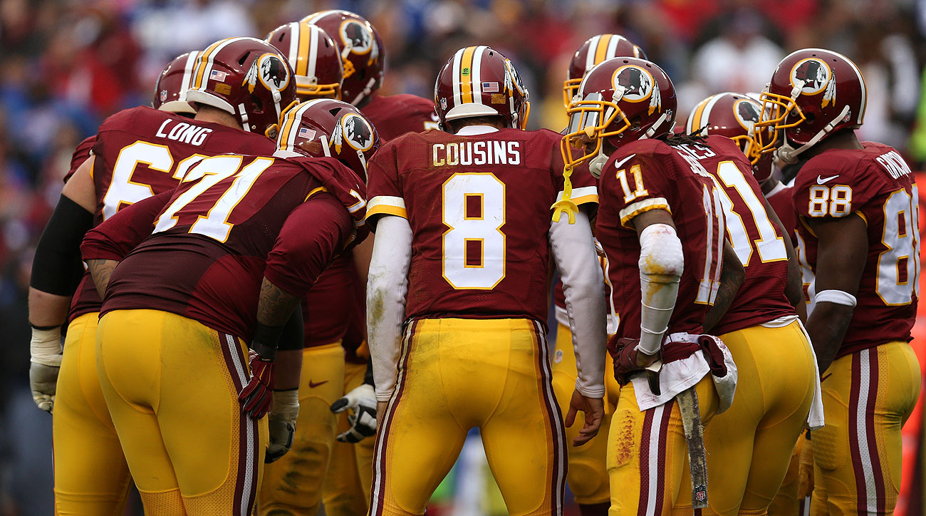 Kirk Cousins of the Washington Redskins takes charge in the huddle.