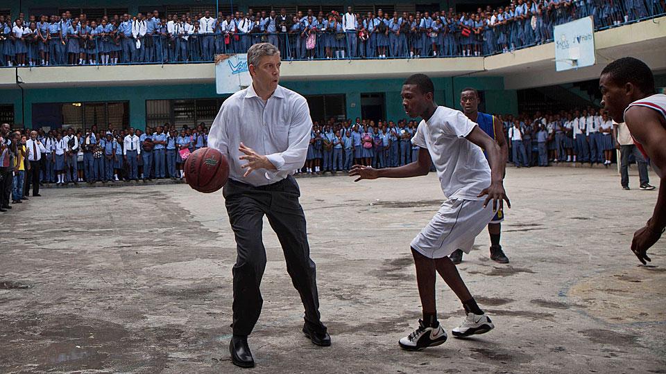 Duncan dropped his jacket and practiced some basketball diplomacy during a visit to a Haitian high school in 2013.