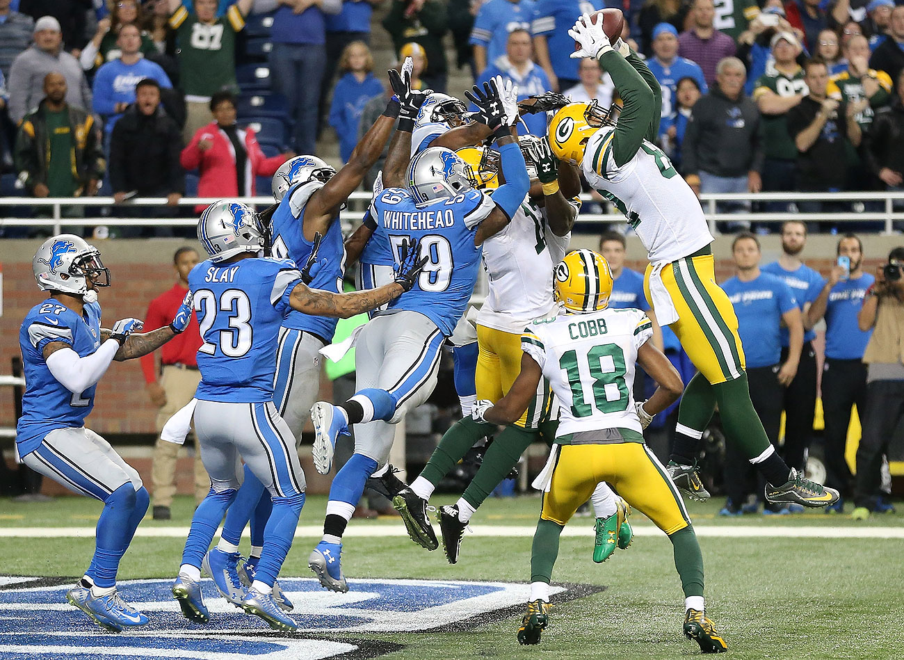 Richard Rodgers high-points the football in front of Lions defenders to secure the Packers' miraculous win.