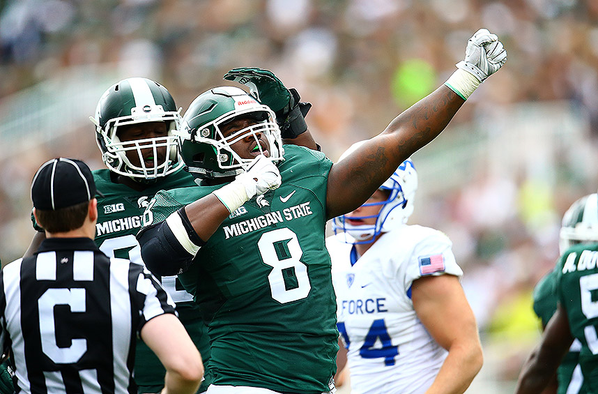 Michigan State 35, Air Force 21: The Spartans couldn't get much going on the ground against the Falcons, but Connor Cook threw four touchdown passes, three of which were caught by Aaron Burbridge.