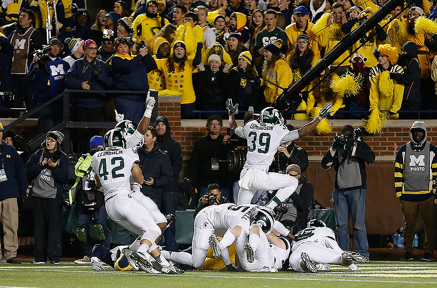 Michigan State 27: Michigan 23: Who could forget the ending to this one? The Spartans and Wolverines created an instant classic when Michigan's punter improbably fumbled a snap on the final play and Jalen Watts-Jackson recovered it for a touchdown, stunning the Wolverine crowd.