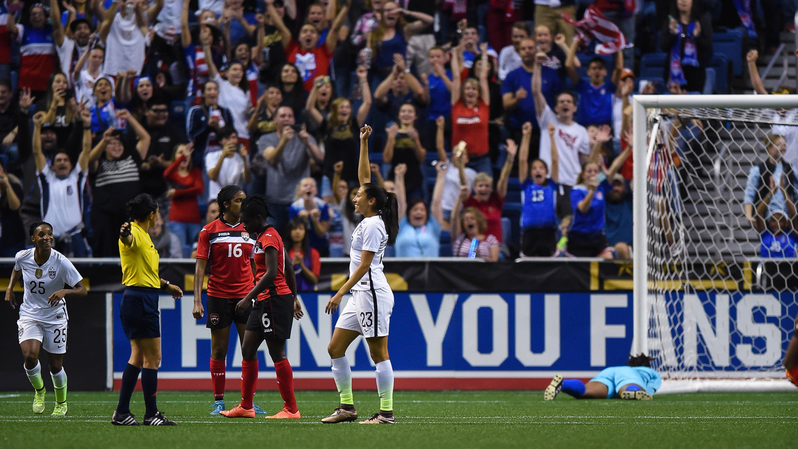 Christen Press triumphantly raises her hand after a goal during her hat trick in a 6-0 rout of Trinidad & Tobago at the Alamodome in San Antonio.