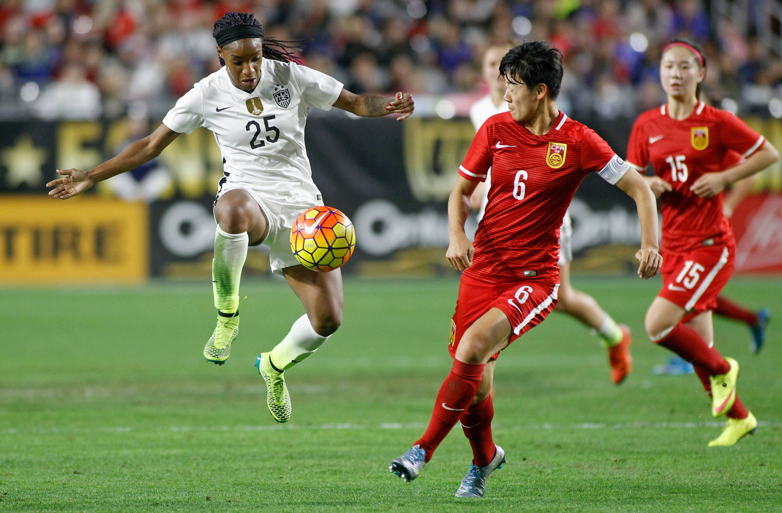 Crystal Dunn leaves her feet to settle a pass in the USA's 2-0 win over China at University of Phoenix Stadium in Glendale, Arizona. Dunn and Christen Press scored the goals.