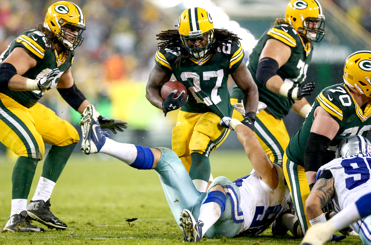 Eddie Lacy of the Packers carrying against the Cowboys at Lambeau Field in Week 14 of the 2015 NFL season.