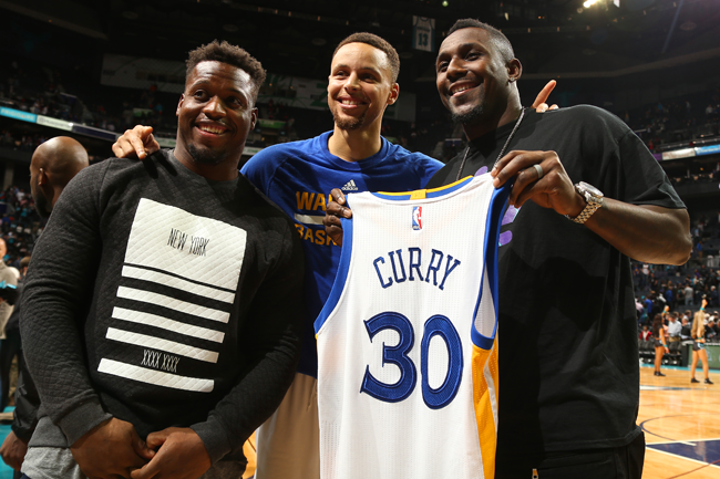 Jonathan Stewart (l.) and Thomas Davis meet with Stephen Curry after the  Warriors 70bbd7f8d
