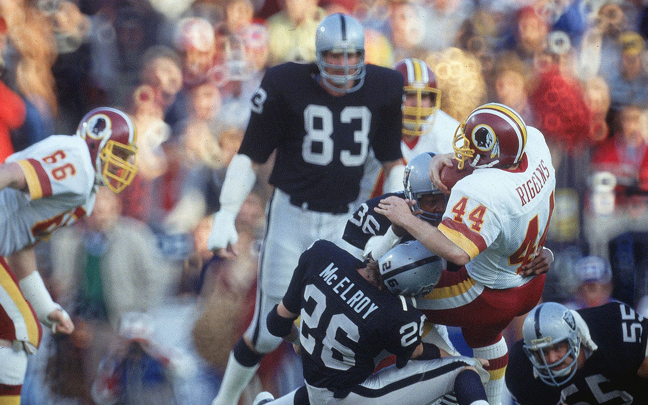 Washington Redskins QB John Riggins, #44, in action vs Los Angeles Raiders Vann McElroy