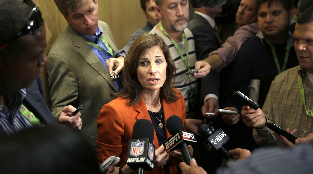 Lisa Friel, who oversees the NFL's domestic violence policy, speaks to reporters.