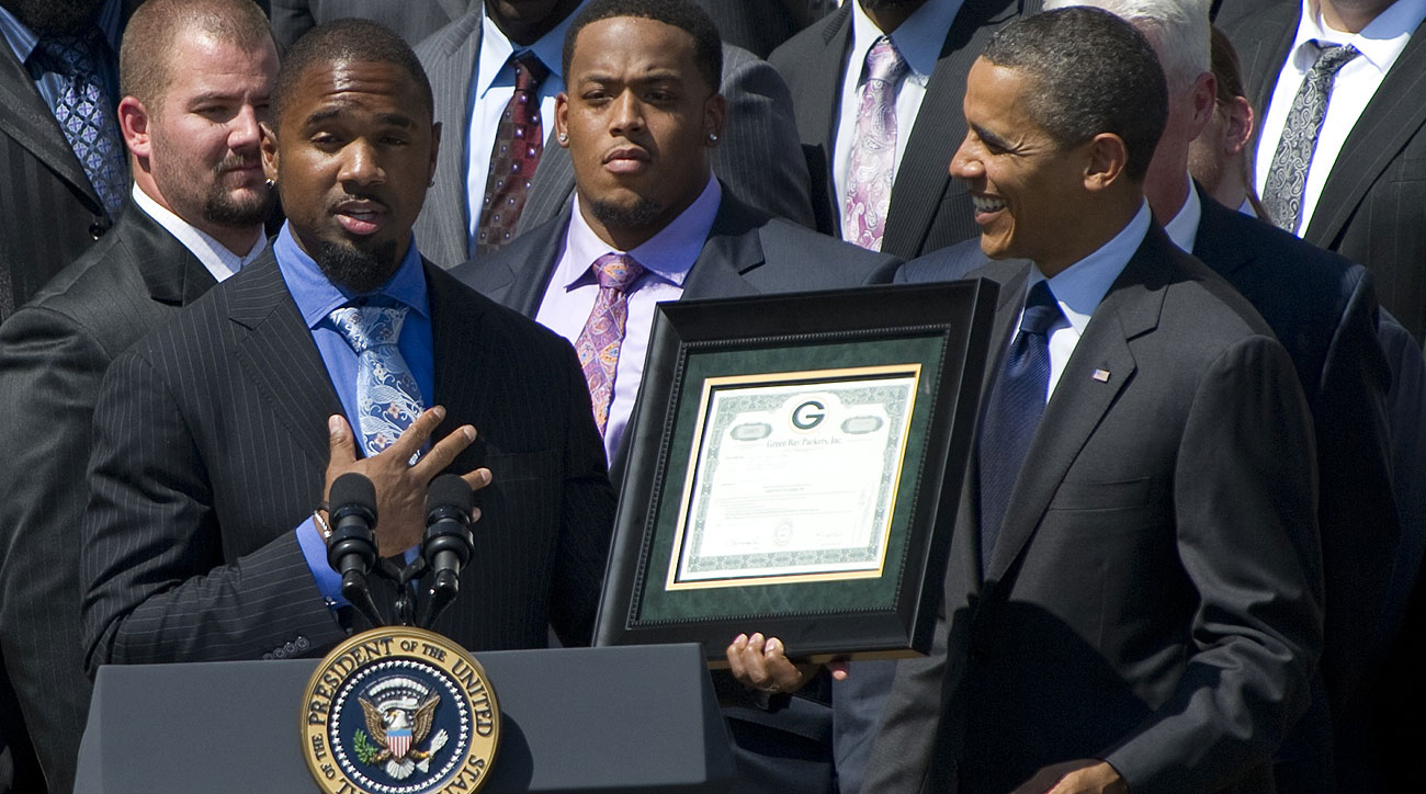 Woodson (holding frame) and the Packers visited President Obama after winning the Super Bowl following the 2010 season.