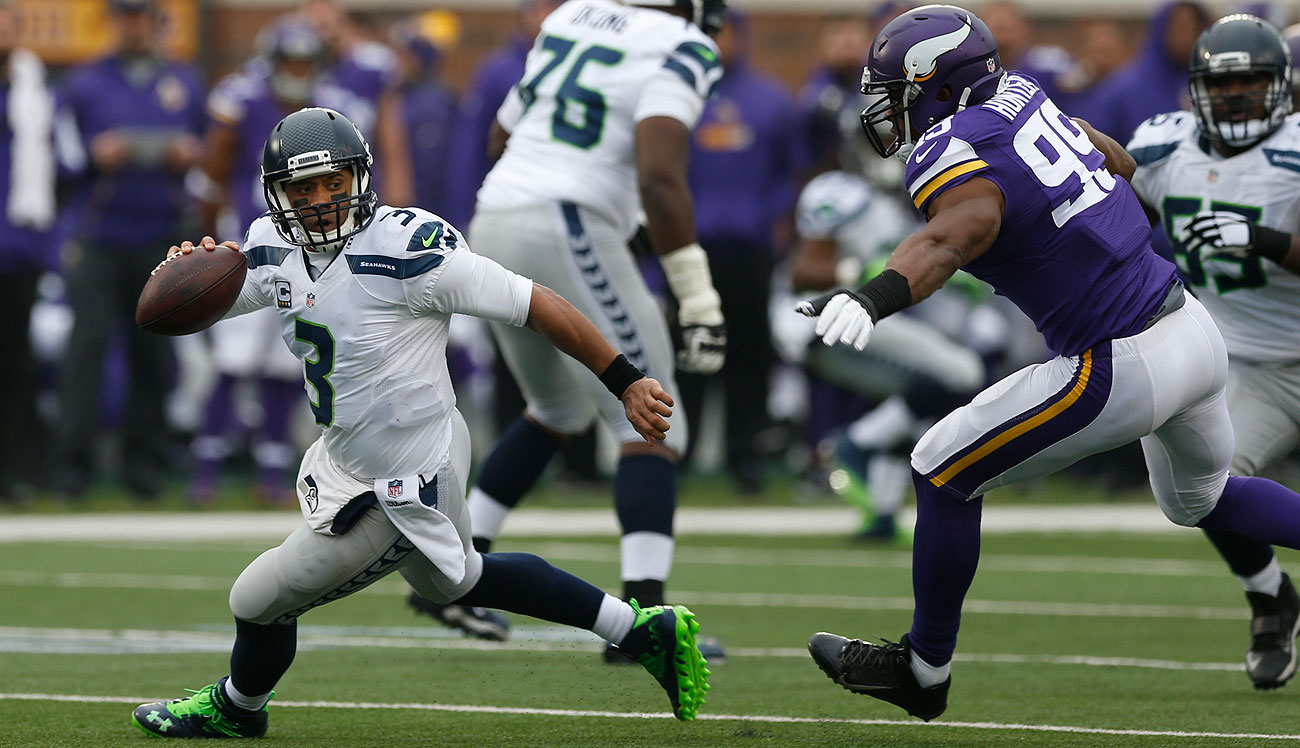 The Seahawks-Vikings wild-card game will be a rematch of their early December meeting. Russell Wilson scored four TDs in a 38-7 win.