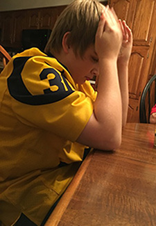 A young Rams fan reacts to the news that his team is leaving for L.A.
