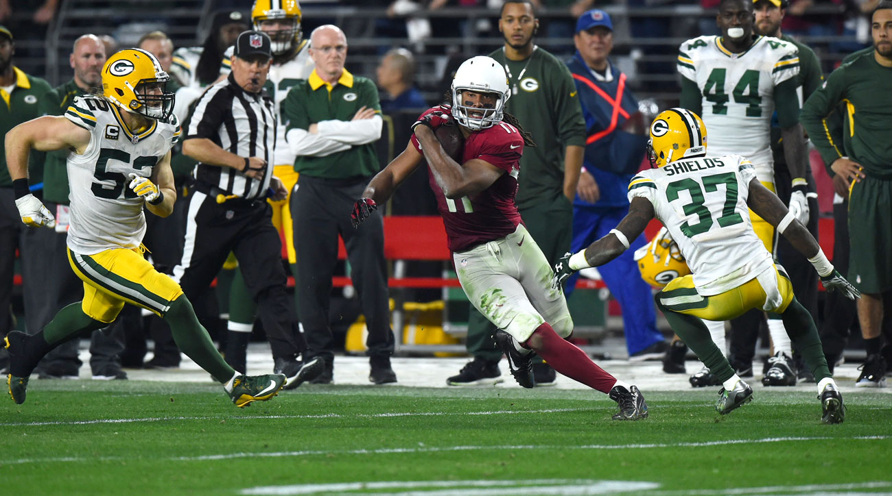 Fitzgerald cuts back during his 75-yard catch-and-run in the Cardinals' wild win over the Packers.