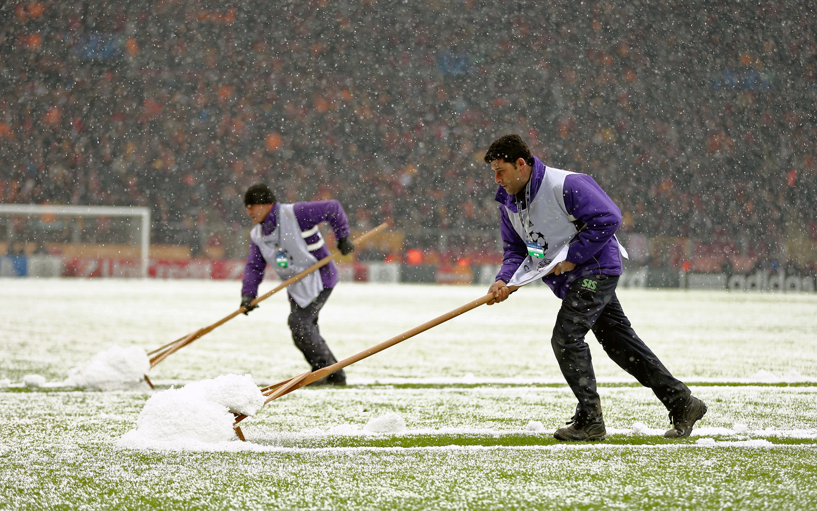Groundsmen clear the field in Istanbul at the Champions League match between Galatasaray and Juventus.
