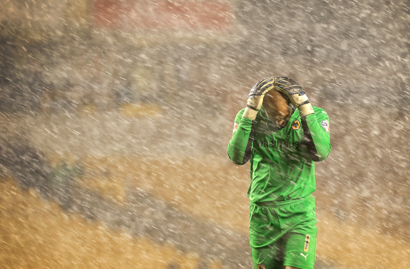 Wolverhampton goalkeeper Carl Ikeme can't stand the elements in an FA Cup replay against Fulham in January 2015.