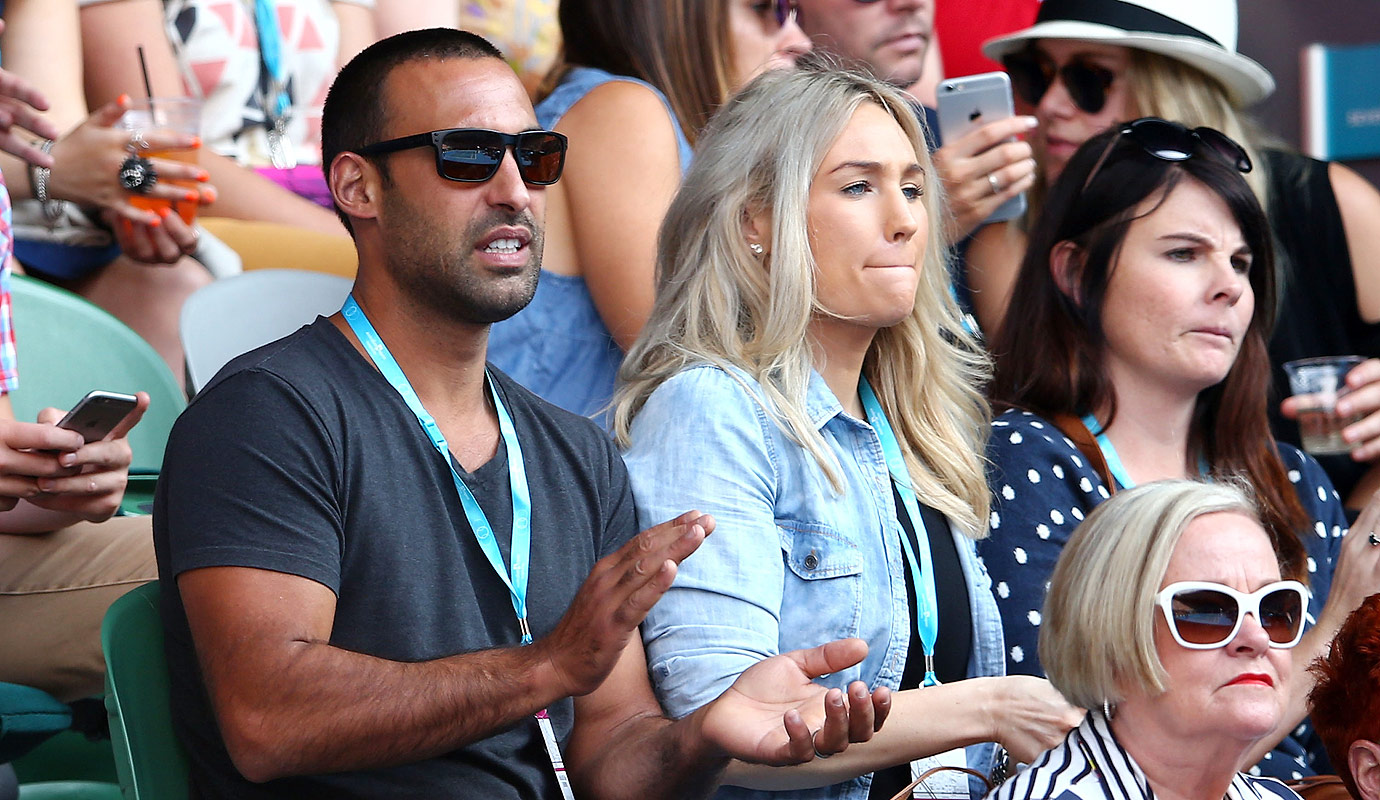 Adam Dovile and wife Lisa Lamond watch the fourth round match between Stan Wawrinka of Switzerland and Milos Raonic of Canada during day eight of the 2016 Australian Open at Melbourne Park on January 25, 2016 in Melbourne, Australia.