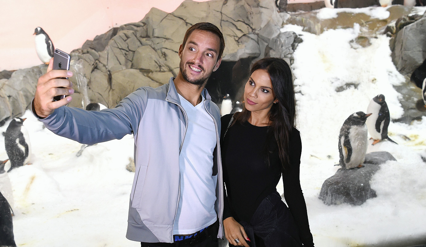 Viktor Troicki of Serbia taking a selfie with girlfriend Aleksandra Djordjevic at the Melbourne Aquarium during day five of the 2016 Australian Open at Melbourne Park on January 22, 2016 in Melbourne, Australia.