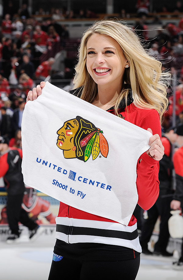 A Chicago Blackhawks ice-crew girl skates during the game between the Chicago Blackhawks and the St. Louis Blues at the United Center in Chicago.
