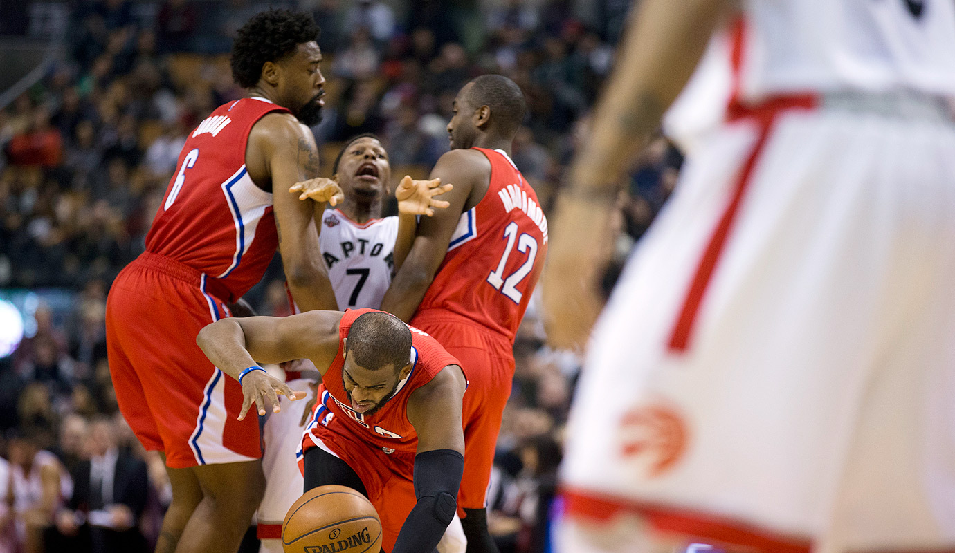 Kyle Lowry is picked by LA' DeAndre Jordan and Luc Mbah a Moute as he chases after Chris Paul in the first half. The Toronto Raptors hosted the Clippers Sunday night at the ACC in Toronto.