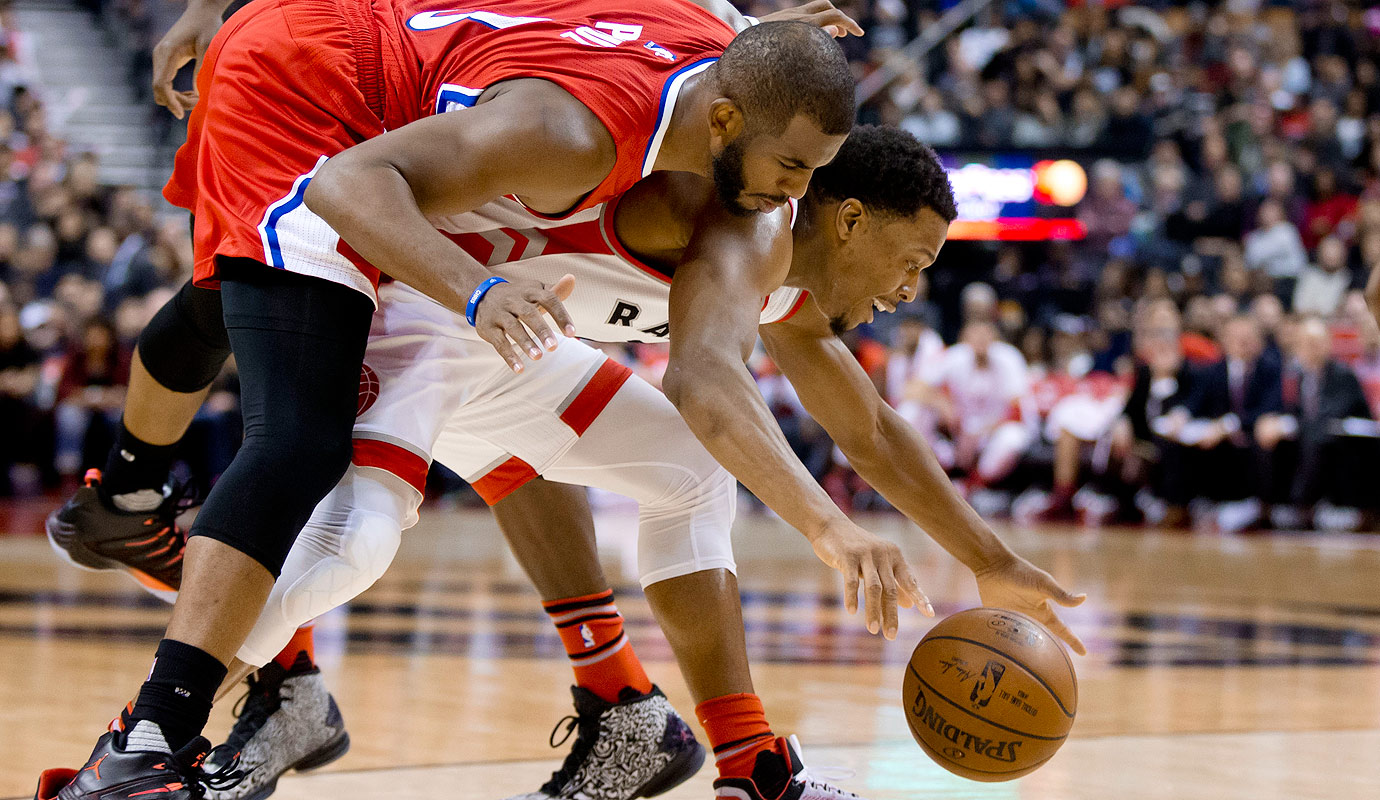 Chris Paul fouls Toronto's Kyle Lowry in the second half. The Toronto Raptors hosted the Clippers Sunday night at the ACC in Toronto and won 112-94.