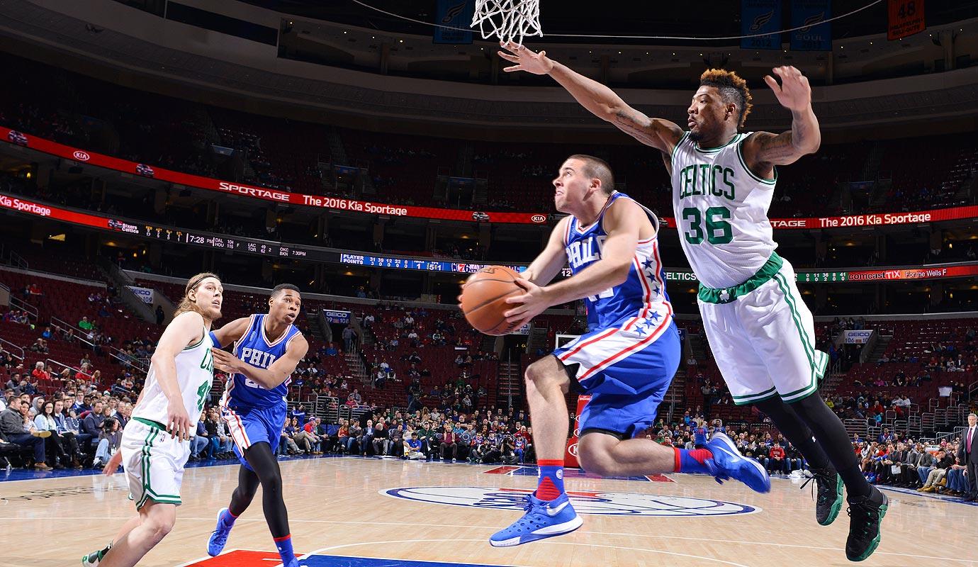 T.J. McConnell #12 of the Philadelphia 76ers goes up for the reverse layup against the Boston Celtics at Wells Fargo Center on January 24, 2015 in Philadelphia, Pennsylvania.
