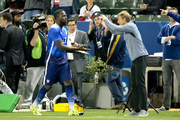 Jozy Altidore gets a congratulatory greeting from Jurgen Klinsmann after scoring for the USA vs. Canada