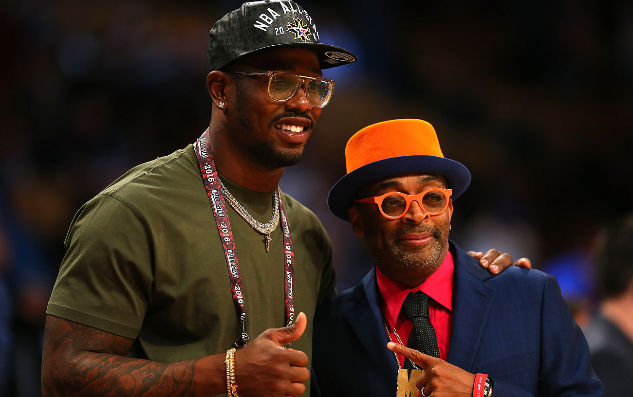 Miller posed with filmmaker Spike Lee courtside at the NBA All-Star Game in Toronto.
