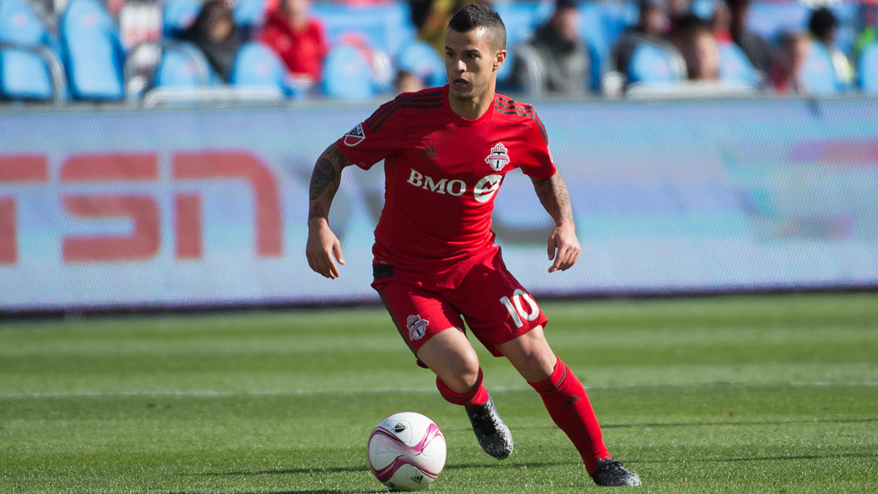 Sebastian Giovinco tried to chip Luis Robles from the center circle
