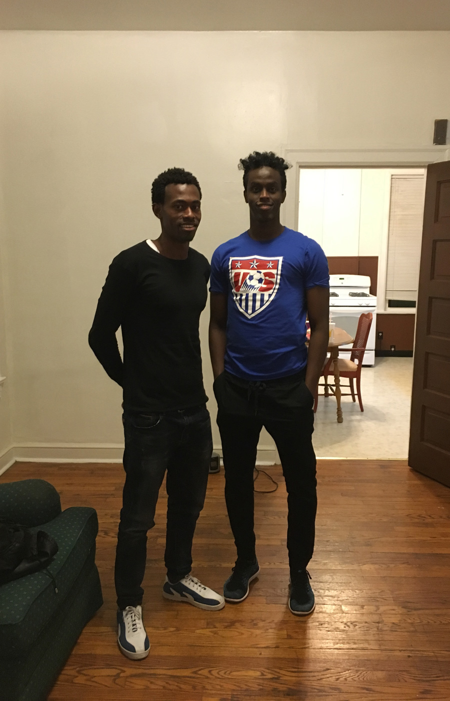 Sa'ad Hussein (L) and Saadiq Mohammed (R) at Sa'ad's new apartment–just after his arrival in the USA–in the Gravois Park neighborhood of St. Louis.