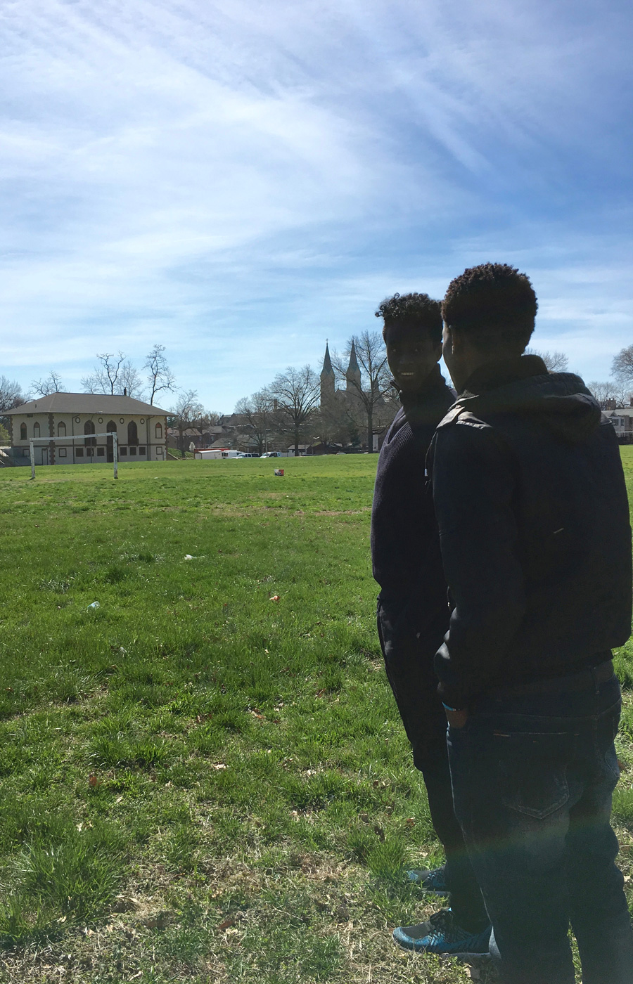 Saadiq Mohammed and Sa'ad Hussein, looking at the soccer field at Marquette Park, which is two blocks from Sa'ad's new apartment.