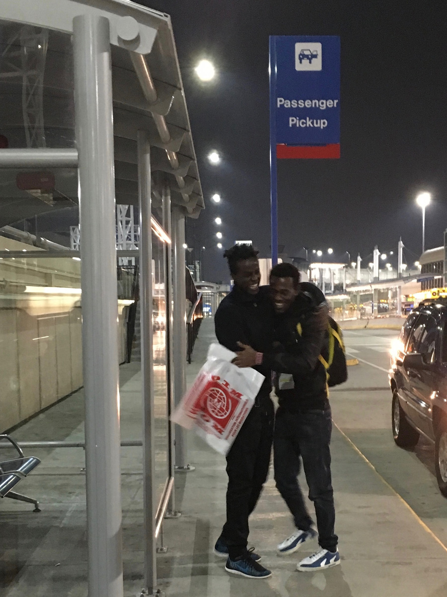 Sa'ad Hussein and Saadiq Mohammed reunite at Lambert-St. Louis International Airport.