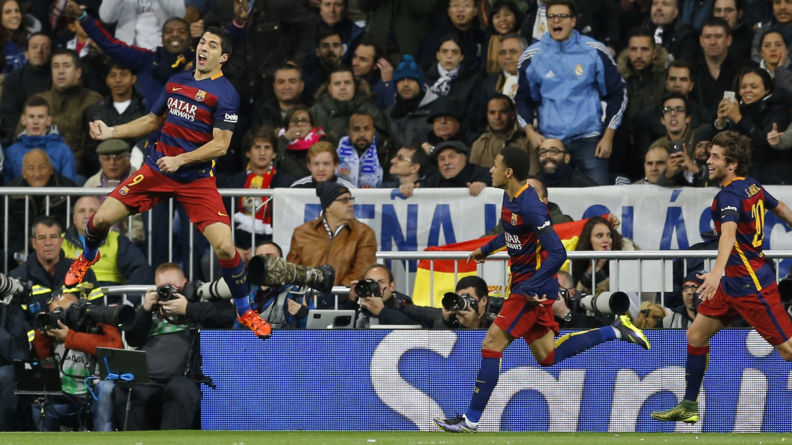 Barcelona's Luis Suarez leaps for joy after scoring in a 4-0 rout at Real Madrid.